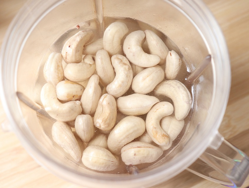 Raw organic cashew nuts soaked in fresh cold water overnight for making milk