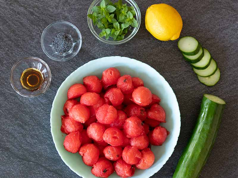 Simple, whole food ingredients for preparing refreshing summer watermelon salad without feta