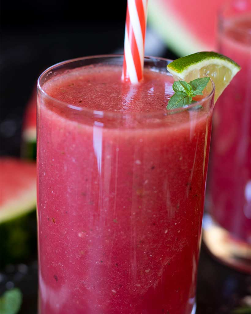 Refreshing summer drink with watermelon, banana, fresh mint and lime juice.