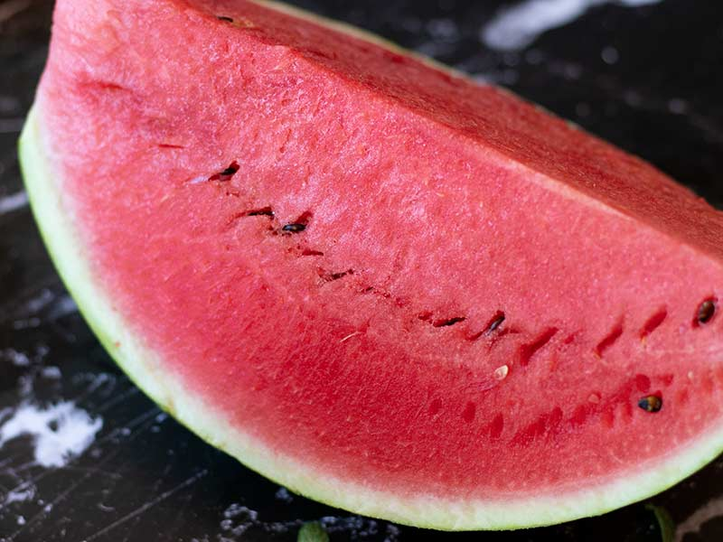 A big slice of fresh and juicy watermelon fruit.