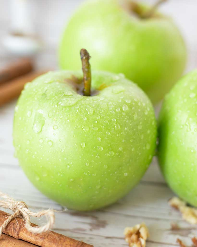 Close up of green apples for baking simple fall cake dessert.