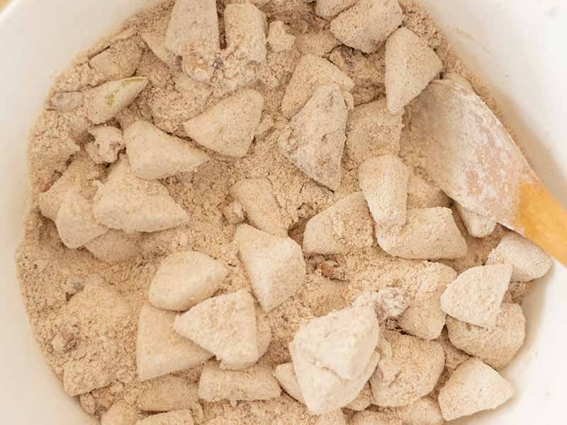 Dry ingredients for making apple cinnamon cake with walnuts