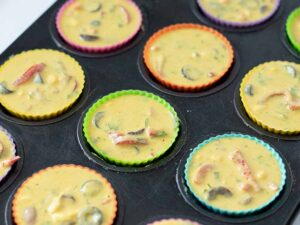 Vegan omlette muffins prepared to be baked at home in muffin tins.