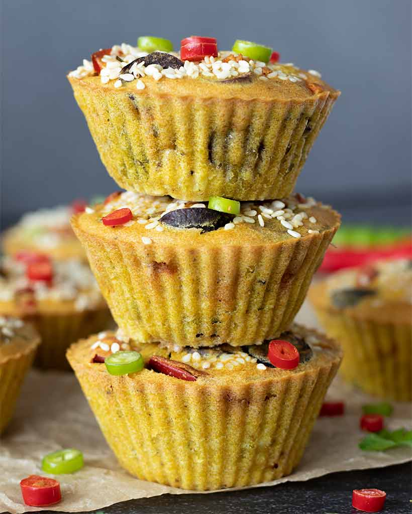 A stack of mini make-ahead chickpea flour frittatas baked in muffin tin for a healthy breakfast or brunch.