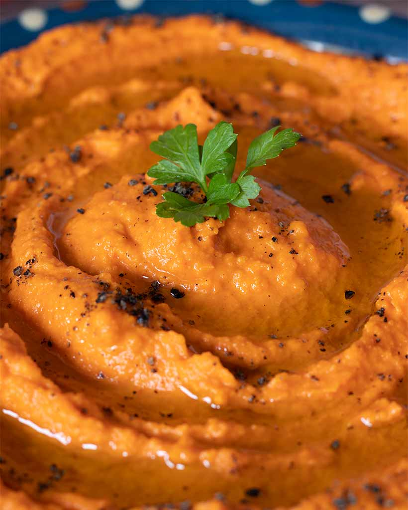 Simple and easy instructions of how to make homemade recipe for roasted red pepper hummus for weeknight dinner. A delicious vegan dip as a side dish or snack.