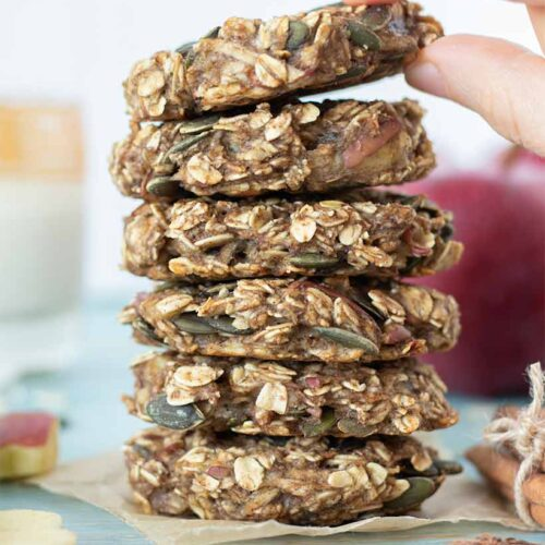 Recipe for apple oatmeal cookies for breakfast or dessert. A stack of healthy cookies with apple, banana, oats, pumpkin seeds and cinnamon.